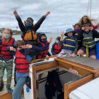 Enthusiastic-campers-enjoying-a-sail-on-Seaward