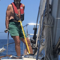 on-Harben-hooked-in-on-the-bow-of-sv-Kachina-on-a-passage-from-Puerto-Vallarta-to-San-Diego-Photo-by-Susan-Lyons