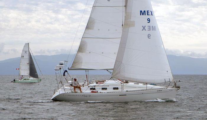 A Beneteau and a trimaran sailing