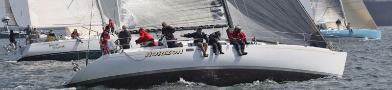 three boats racing