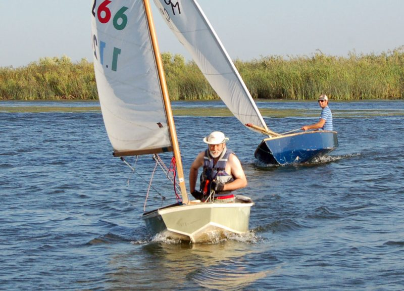 Men racing dinghies