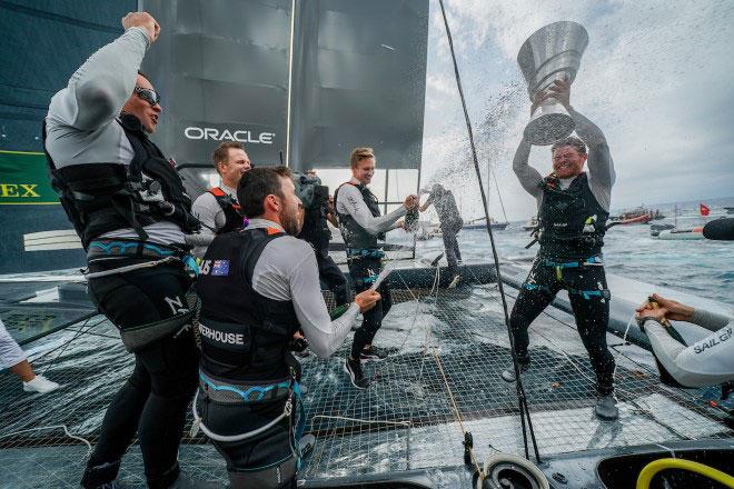 Celebration with trophy aboard boat