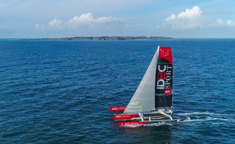 IDEC Sport sails past an island