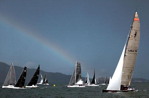 Rainbow over yachts racing