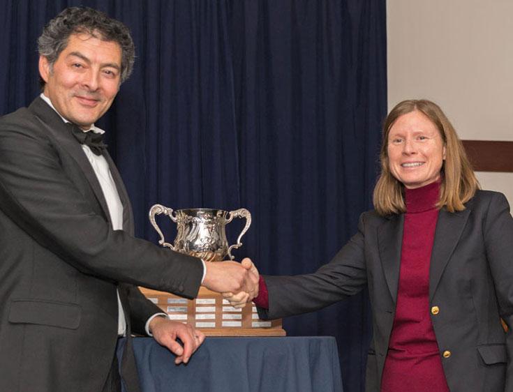 Nicole receiving trophy