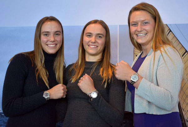 Three teenage girls with Rolex watches