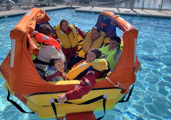 Inflated liferaft in pool.