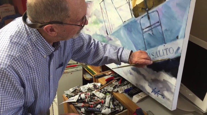 Jim DeWitt working on a canvas