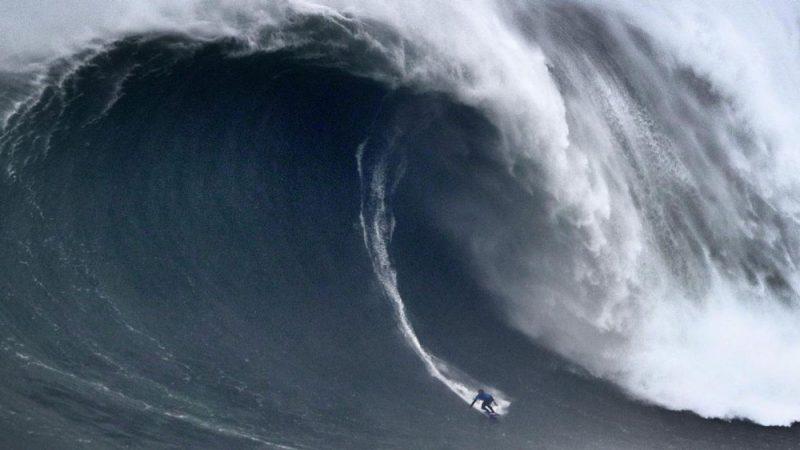 surfer on huge wave