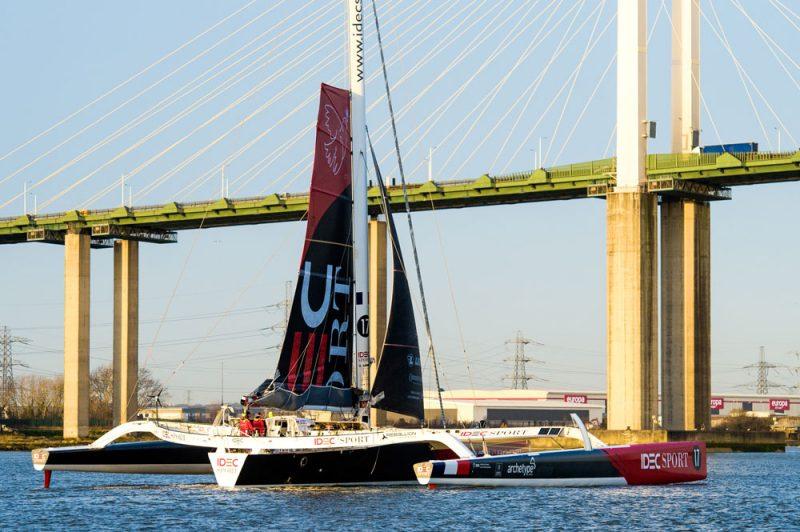 IDEC Sport sails up to the Queen Elizabeth II Bridge.