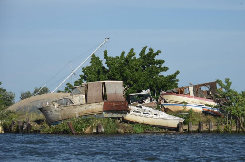 Boats hauled out on river bank