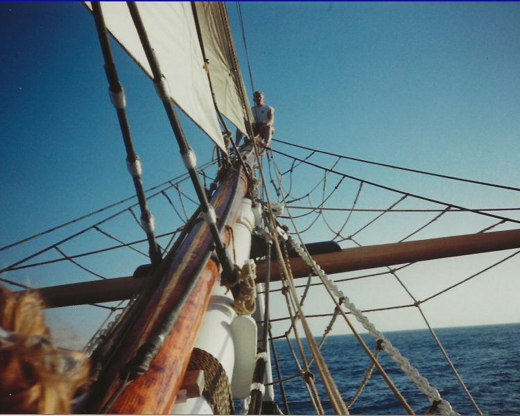 Captain Jim climbing to the tip of the bowsprit of Pilgrim