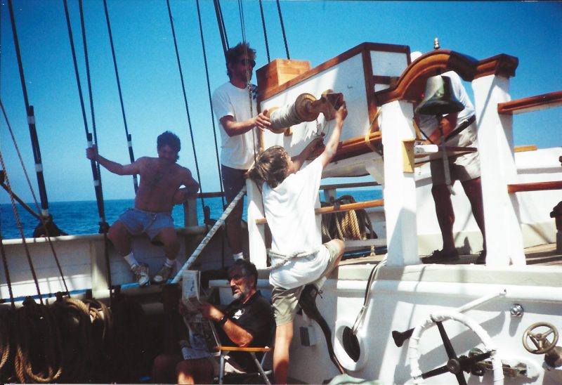 The crew of Pilgrim working the lines on deck