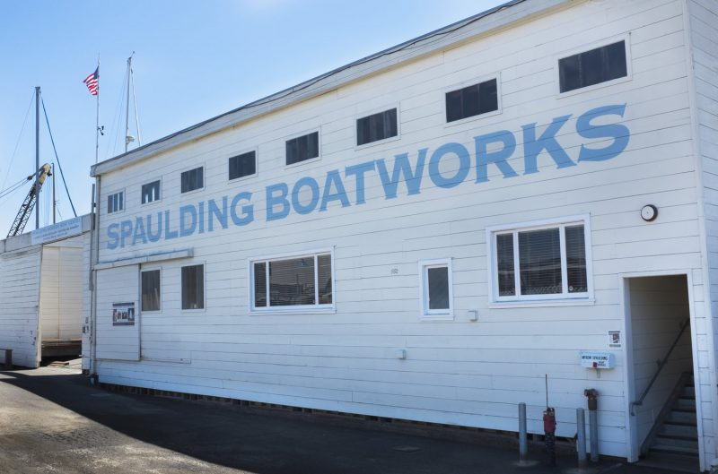 The exterior of the building, with the words Spaulding Boatworks
