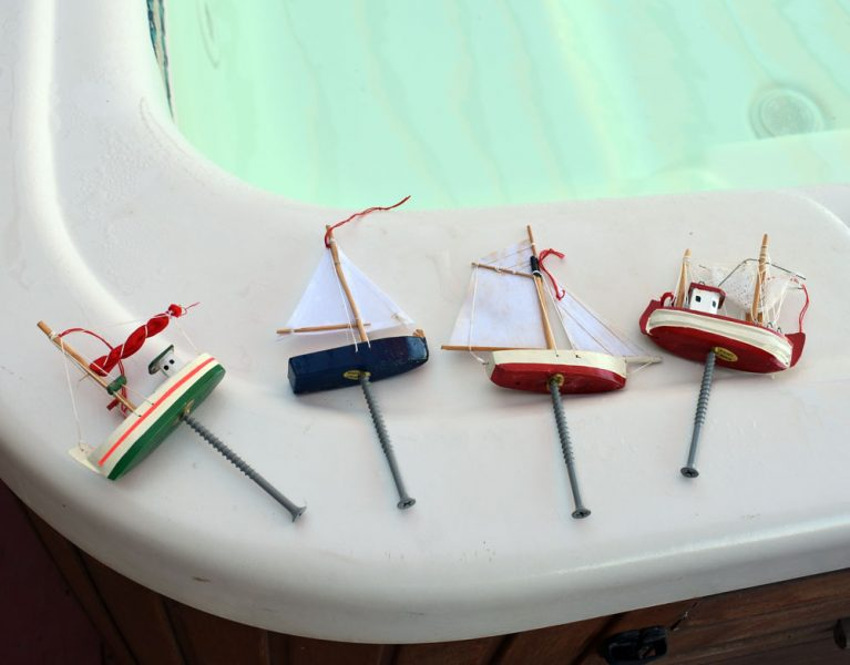 Boat ornaments with screws in the bottom