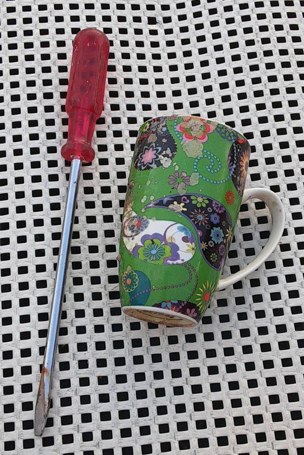 Screwdriver and coffee mug
