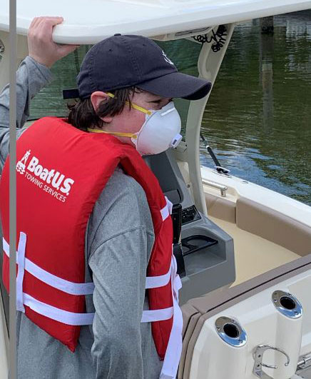 Kid wearing filter mask and PFD