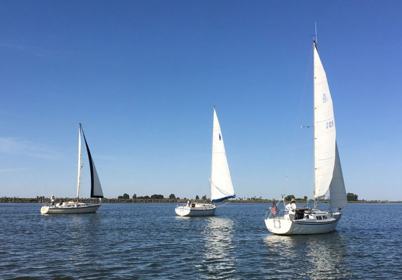 Three boats sailing on the San Joaquin River