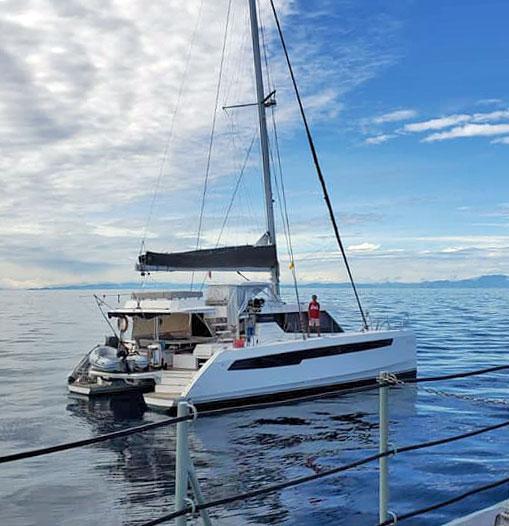 wong solo sailor aboard catamaran