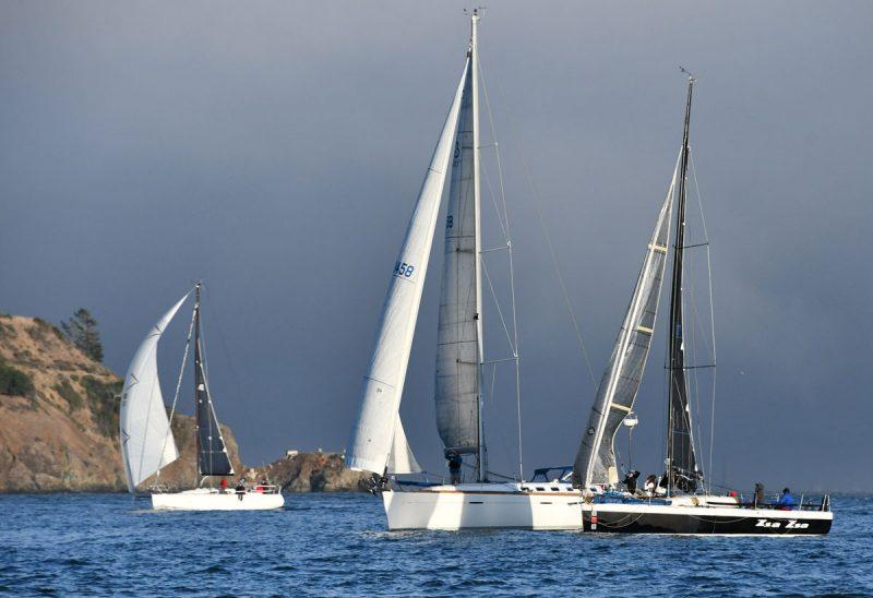 Three boats sail past Angel Island