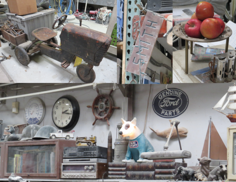 """Stuff around the shop at Elkhorn Composites, and old rusty tractor toy, a wooden sign with the name """"SMITH"""" carved on it, a metal tray with 3 fresh apples, and a wall with collectibles"""