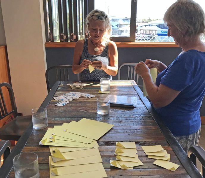 Ladies peeling labels