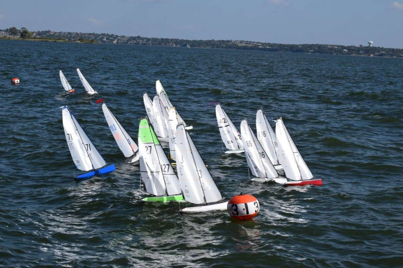 A fleet of DF95 model sailboats races their 2019 North American Championships