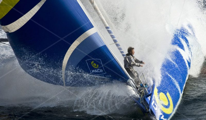 Gabart on the bow of his IMOCA