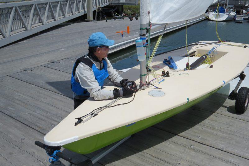 Toshi Takayanagi is rigging his green Laser