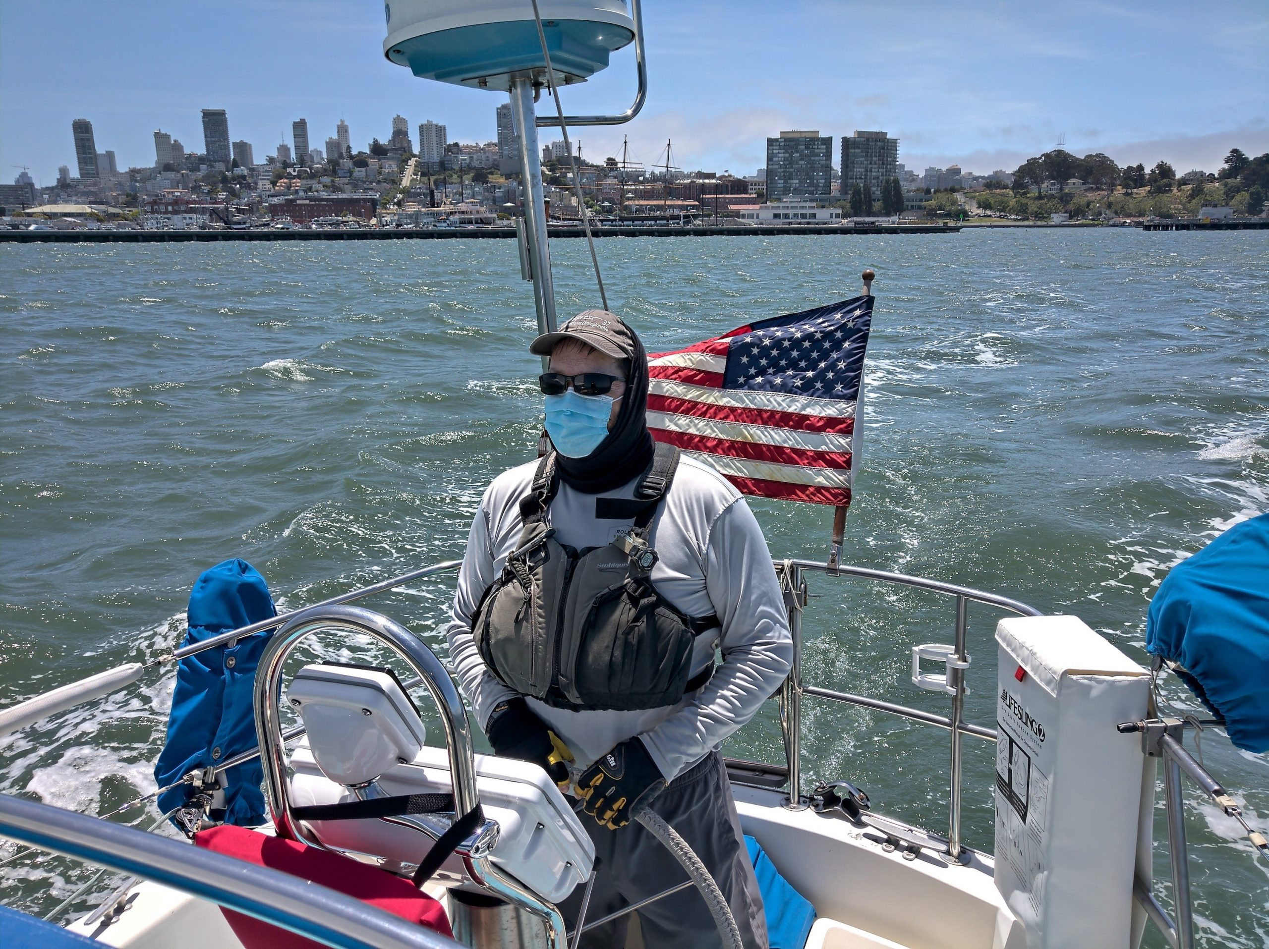 Masked sailor at the helm