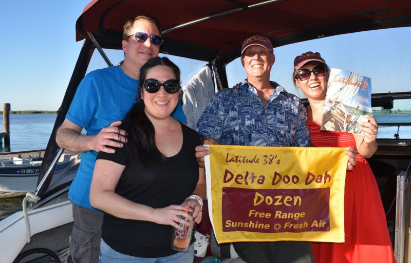 2 couples with Delta Doo Dah flag and magazine