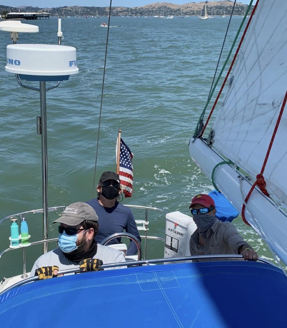 Three sailors in cockpit