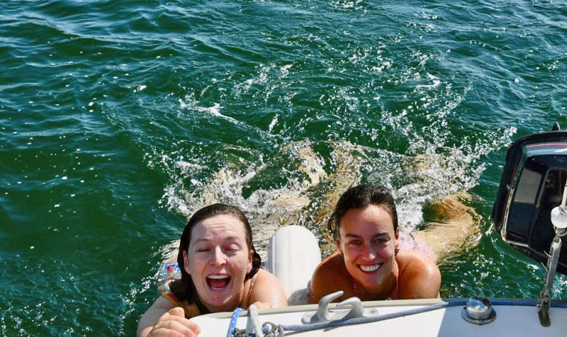 two girls dragging behind a boat