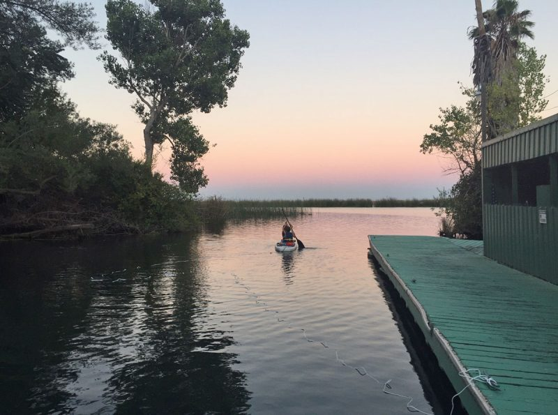 paddlers at sunset in the Delta