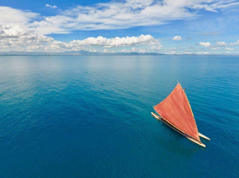Drone shot of drua sailing
