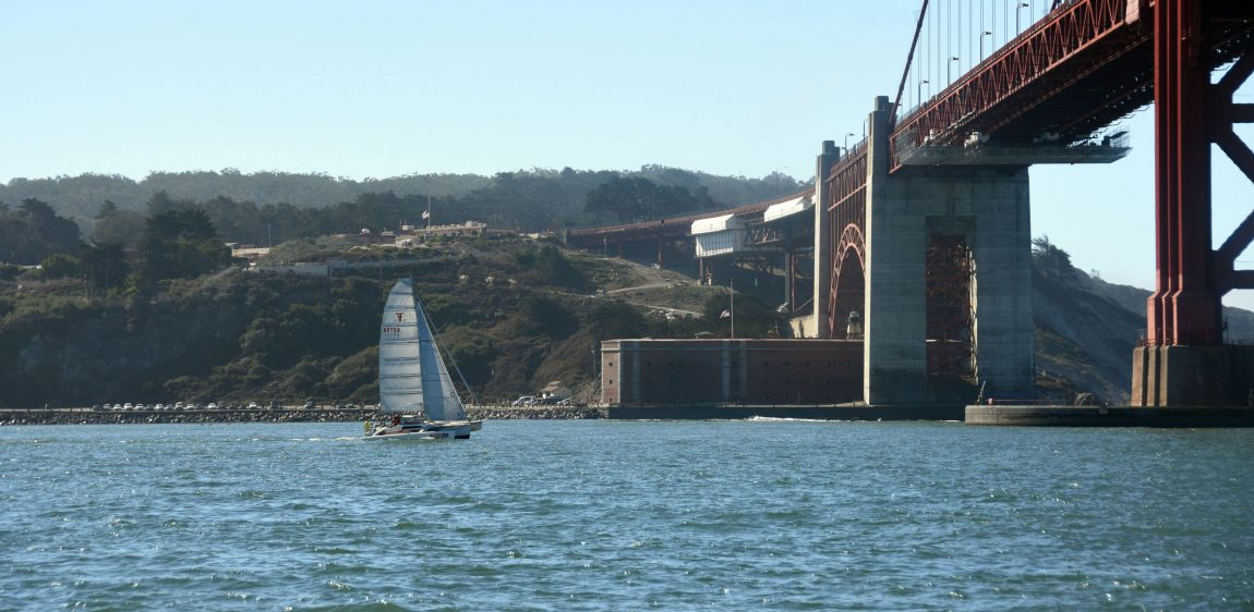 Trimaran sails toward Golden Gate Bridge