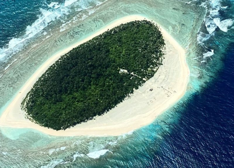 S.O.S. as seen from the air on Micronesian island.