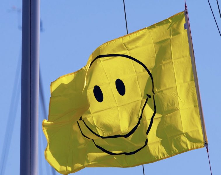 Happy-face flag flies on a neighboring boat