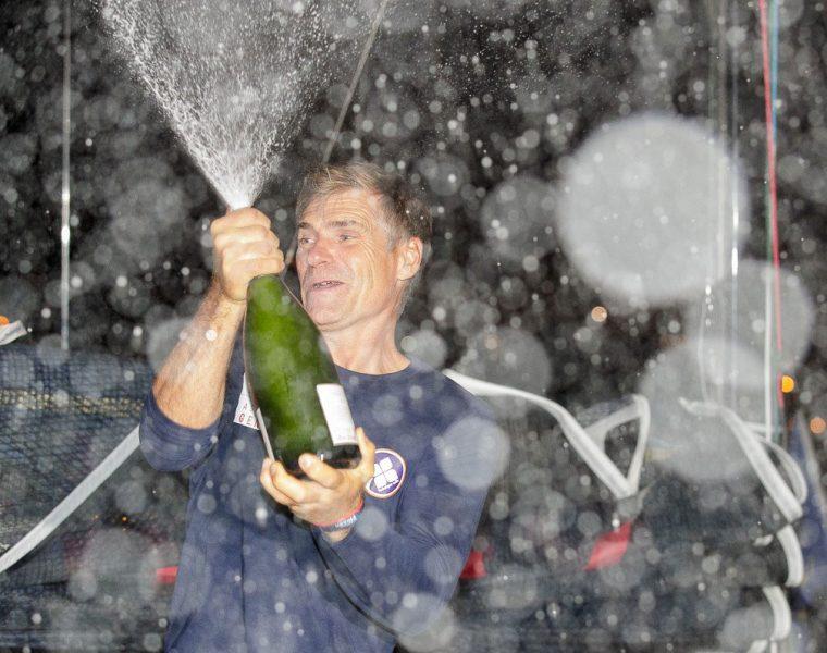 Fred Duthil sprays champagne