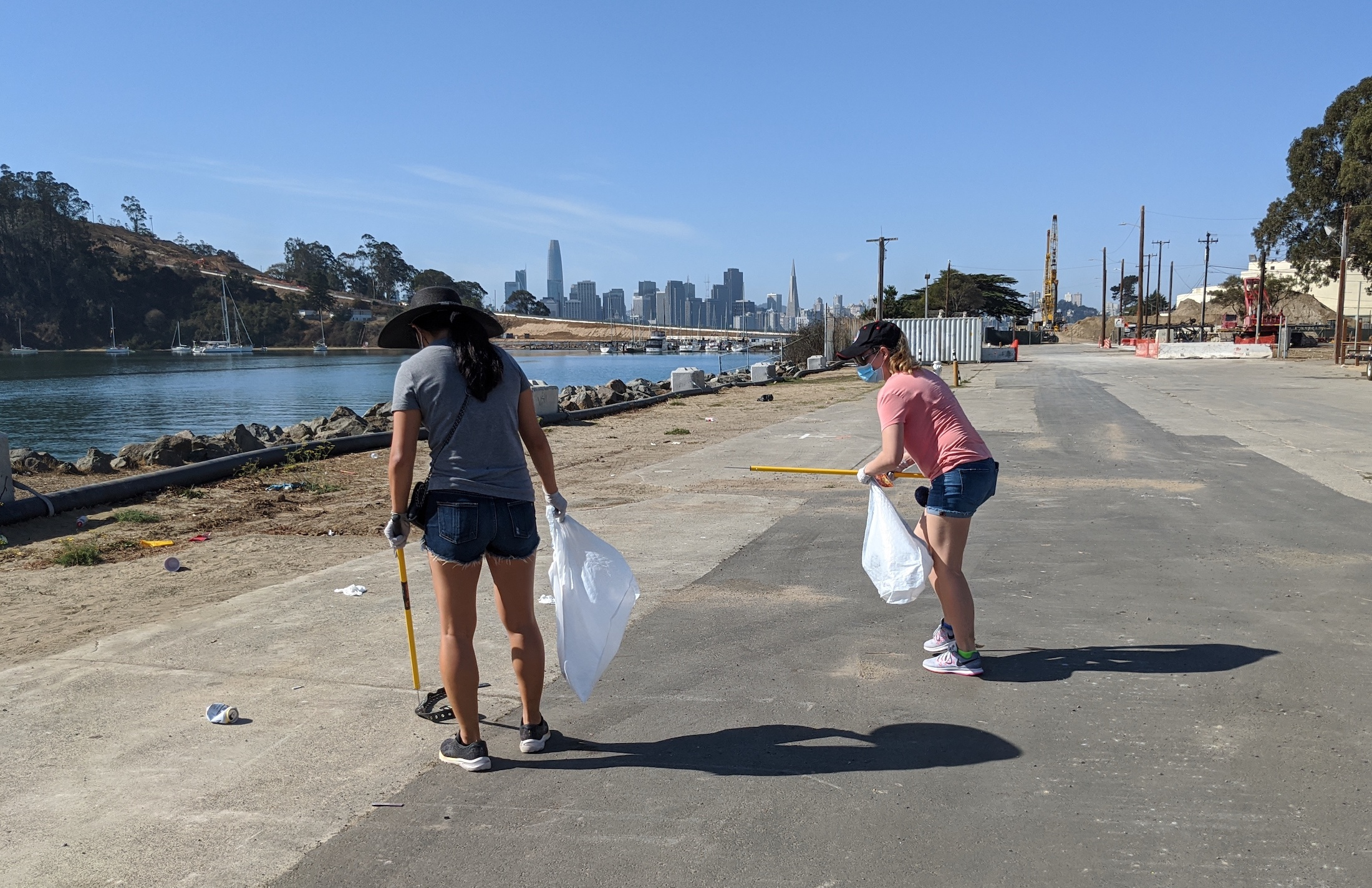 Two volunteers cleaning up at Treasure Island
