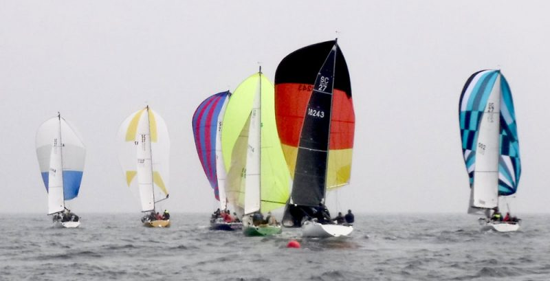 Spinnakers sail away from the offset mark