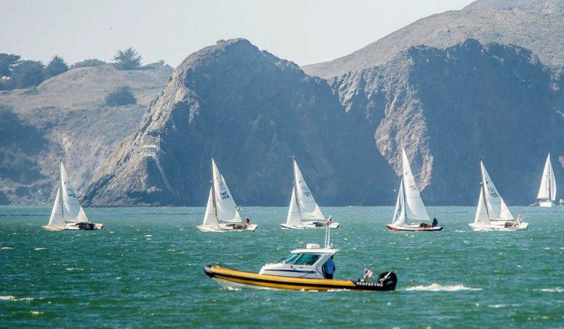 Folkboats sail past the Marin Headlands