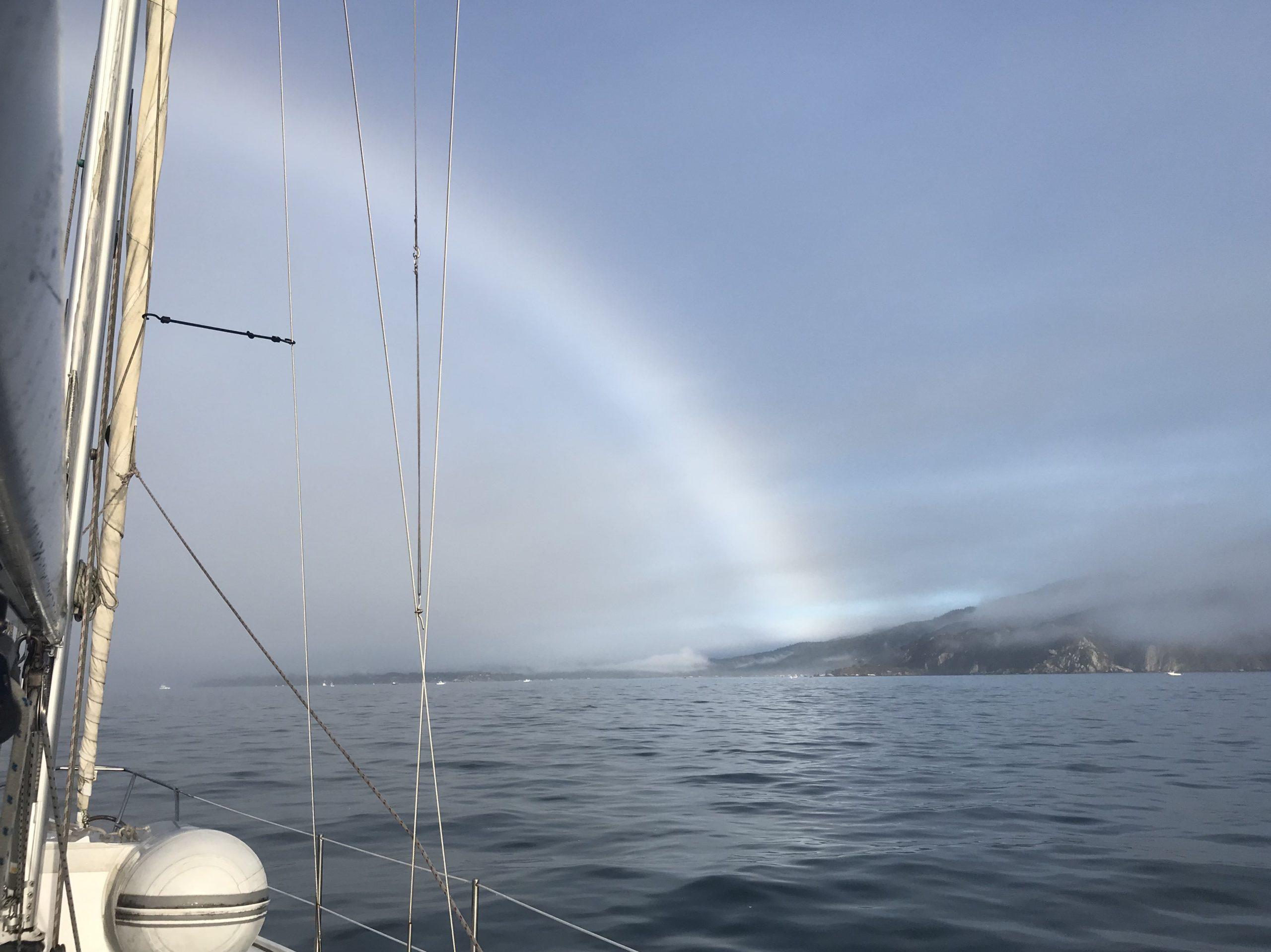 Fogbow landing on shore