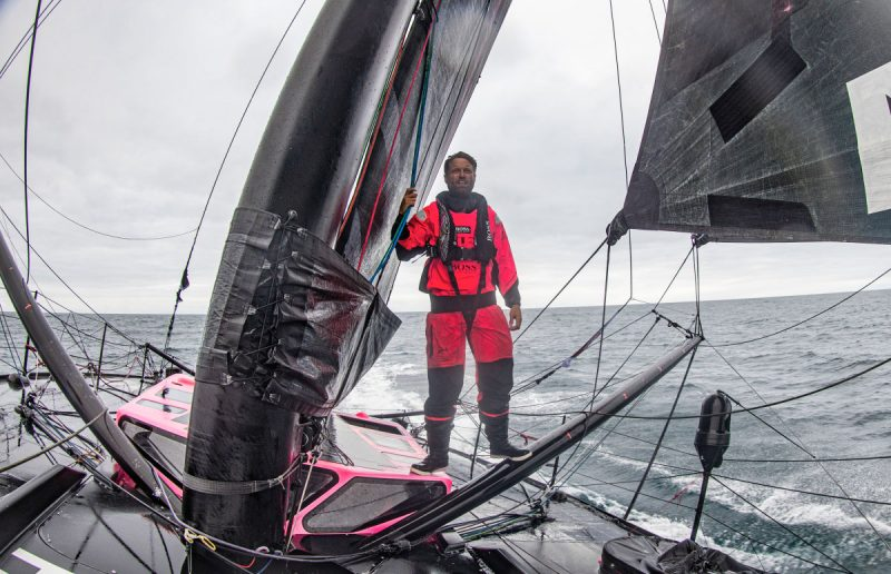 Alex Thomson at the mast