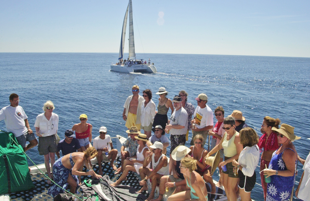 35 sailors gathered on Profligate foredeck in Mexico