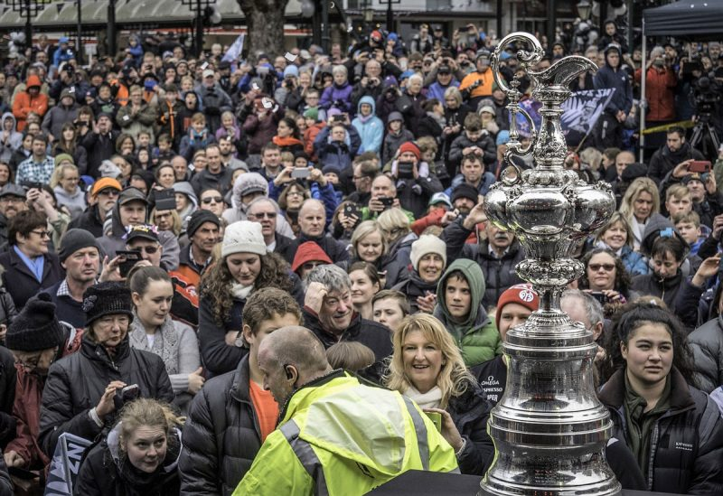 Crowd in the rain with the Cup trophy