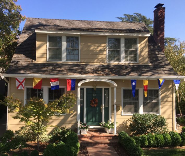 house with signal flags hoisted