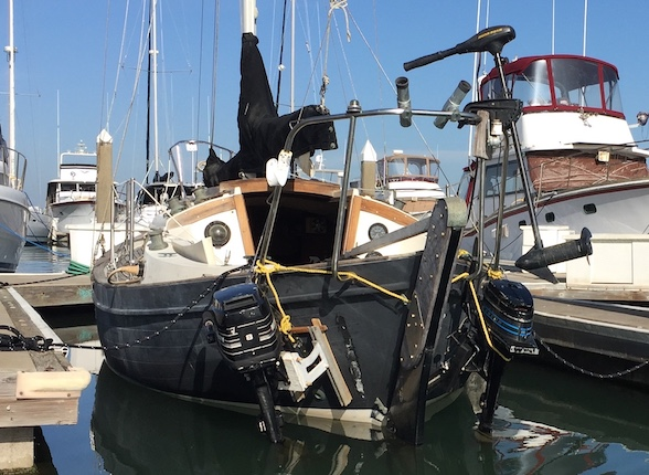 sailboat with two outboards on transom