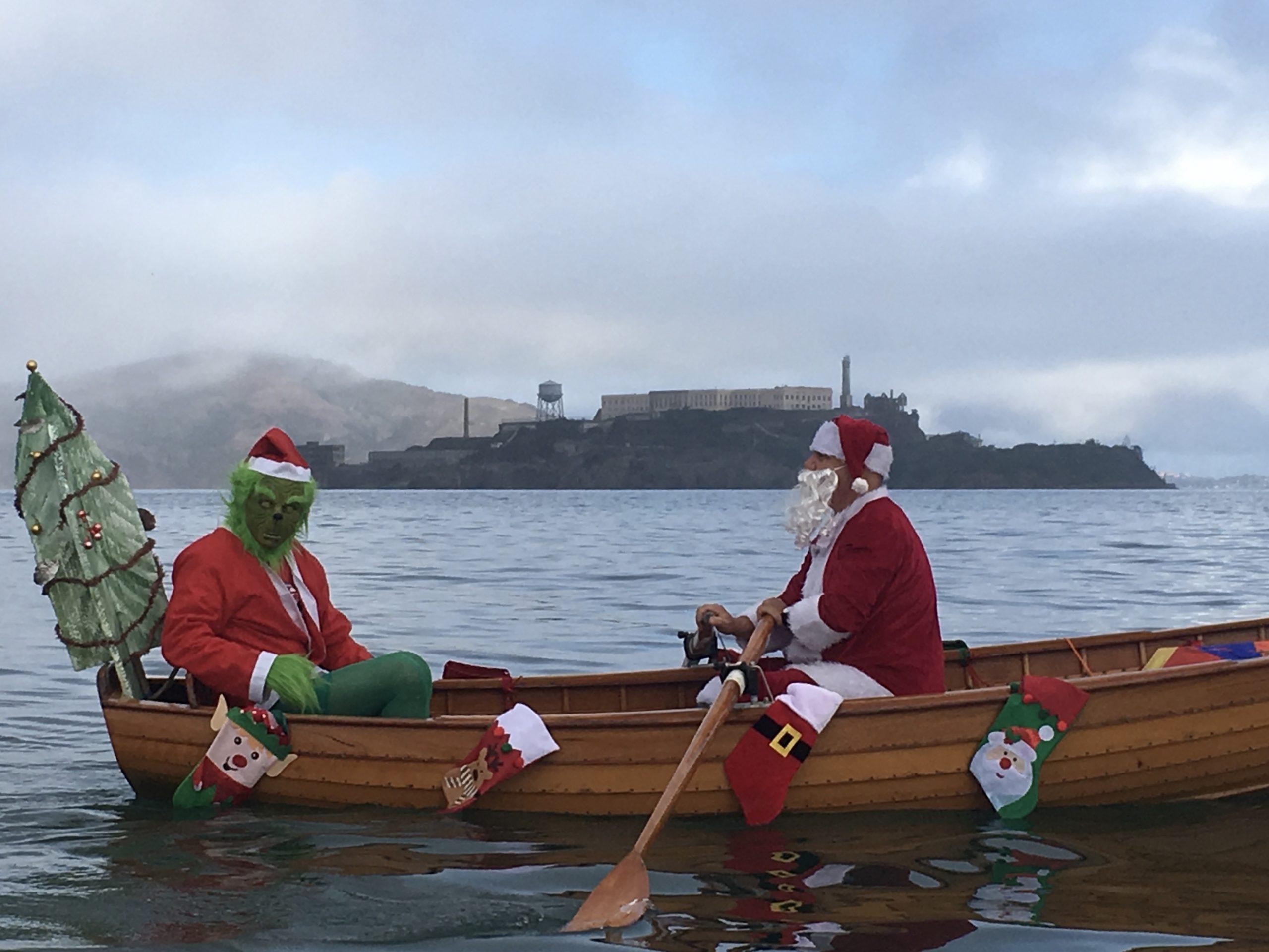 Grinch and Santa rowing