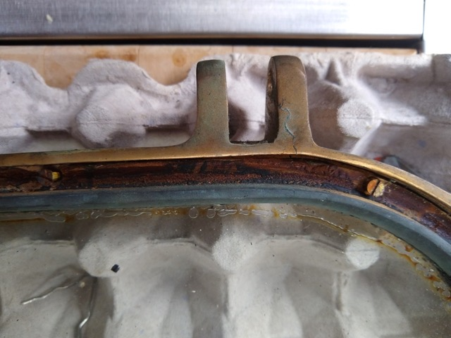 Bronze portlight seal removed